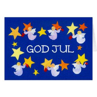 Ángeles y estrellas del navidad con el saludo tarjeta de felicitación