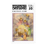 Angels Christmas Postage<br><div class='desc'>Vintage graphic showing angels looking over the Baby Jesus in the manger.  Very nice for your Christmas mailings.</div>