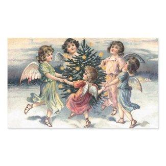 Angels dancing around the Christmas tree