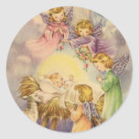 Angels Watching Over Baby Jesus Classic Round Sticker