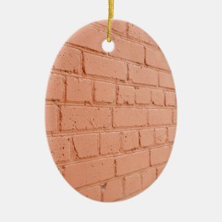 Angle view of a brick wall with a layer of red pai ceramic ornament