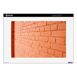 """Angle view of a brick wall with a layer of red pai decal for 15"""" laptop"""
