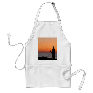 Angler and sunset on shore of the Baltic Sea Aprons