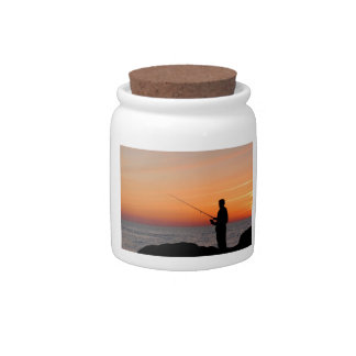 Angler and sunset on shore of the Baltic Sea Candy Jars
