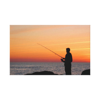 Angler and sunset on shore of the Baltic Sea Canvas Prints