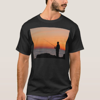 Angler and sunset on shore of the Baltic Sea T-Shirt