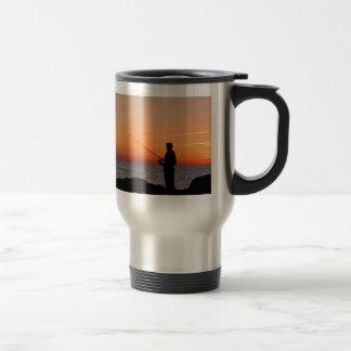 Angler and sunset on shore of the Baltic Sea Travel Mug