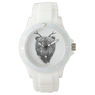Angry bear with antlers watches
