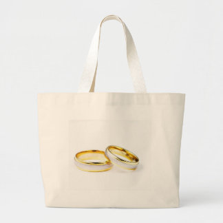 Anillos de bodas de oro en el fondo blanco bolsas de mano