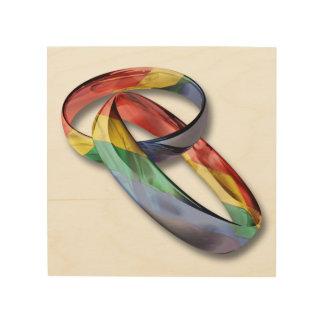 Anillos de bodas del arco iris para la igualdad de impresión en madera