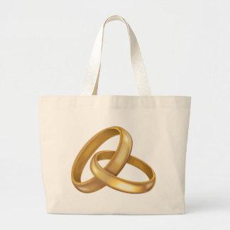 Anillos de bodas del oro entrelazados bolsas de mano