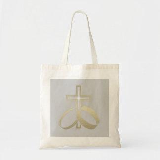 Anillos de bodas del oro y regalos cruzados bolsa tela barata