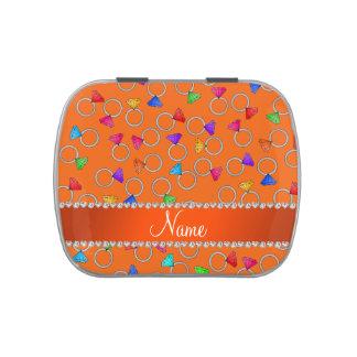 Anillos de diamante anaranjados conocidos latas de dulces