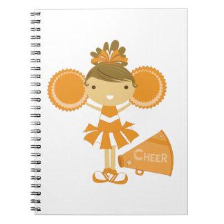 Animadora en naranja cuadernos