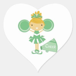Animadora en verde pegatina en forma de corazón