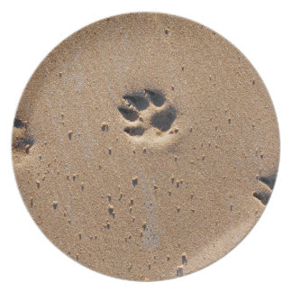 Animal paw prints in sand dinner plate