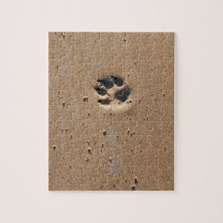 Animal paw prints in sand jigsaw puzzle