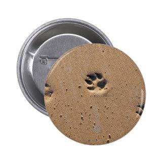 Animal paw prints in sand pinback button
