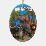 Animales en el parque zoológico adorno navideño ovalado de cerámica