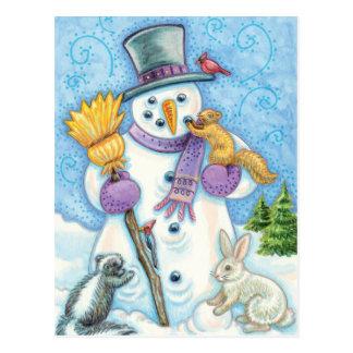 Animales lindos que construyen un muñeco de nieve tarjetas postales