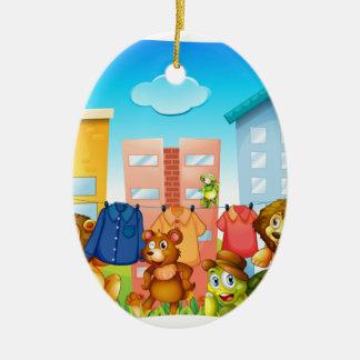 Animals doing laundry outside ceramic ornament