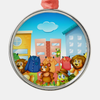 Animals doing laundry outside metal ornament