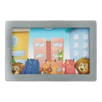 Animals doing laundry outside rectangular belt buckle
