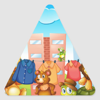 Animals doing laundry outside triangle sticker