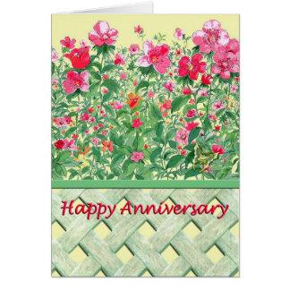 Aniversario rosado y verde de la frontera de la tarjeta de felicitación