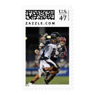 ANNAPOLIS, MD - 25 DE JUNIO:  Justin Smith #2 4 Timbre Postal