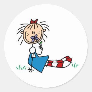 Annie Lying In Grass With Flower Sticker