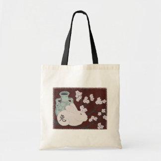 Año chino de la bolsa de asas del conejo