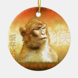 Año chino del mono de oro del mono adorno navideño redondo de cerámica