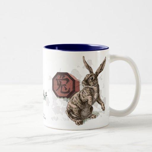 Año del arte chino del zodiaco del conejo taza de dos tonos