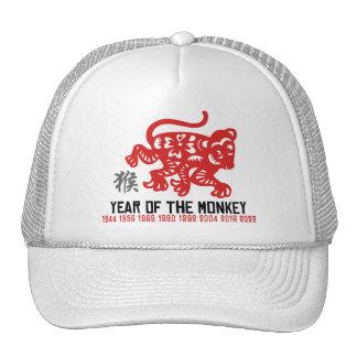 Año del corte del papel del mono gorro de camionero
