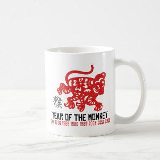 Año del corte del papel del mono taza de café