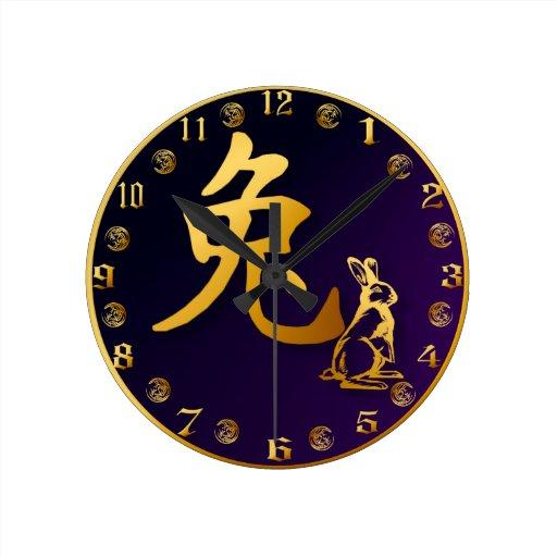Año del oro del reloj del conejo