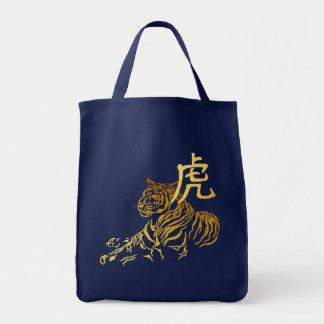 Año del tigre en bolso del oro
