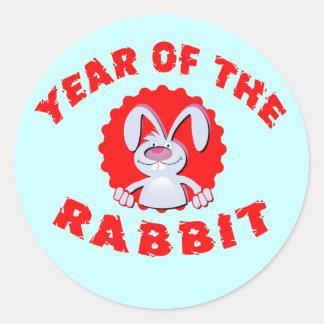 Año divertido del conejo del dibujo animado de los etiquetas redondas