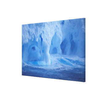 Antarctica. Iceberg with breaking waves Gallery Wrapped Canvas
