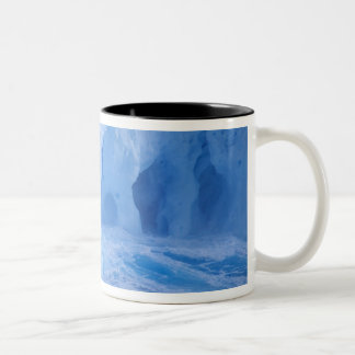 Antarctica. Iceberg with breaking waves Two-Tone Coffee Mug