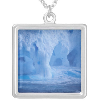 Antarctica. Iceberg with breaking waves Necklaces