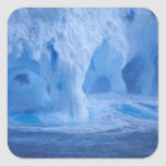 Antarctica. Iceberg with breaking waves Square Sticker
