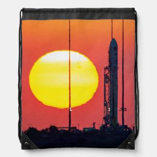Antares Rocket at Sunrise Drawstring Backpack