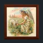 """Antique Angel Feeding A Lamb Jewelry Box<br><div class=""""desc"""">A perfectly beautiful antique angel holds flowers and wears a floral wreath on her head as she compassionately feeds milk to a lamb in a gold dish. Peach colored clouds reflect the setting sun as a flock of birds pass by over a church steeple. The shades of green, white, blue...</div>"""