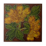 """Antique Autumn Colors Floral Majolica Tile Repro<br><div class=""""desc"""">From our collection: Great fall colors on a richly glazed Chrysanthemum floral tile in shades of amber,  caramel and tust with green,  gold and burgundy/maroon.</div>"""