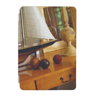 Antique Baseballs On A Table By A Model Sailboat iPad Mini Cover
