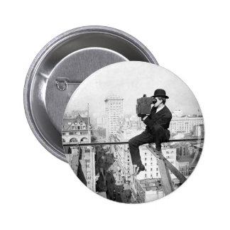 antique camera on a city highrise vintage photo button