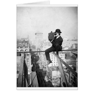 antique camera on a city highrise vintage photo card