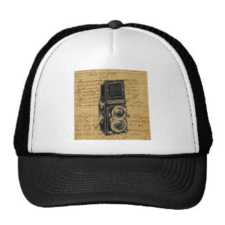 antique camera on burlap background trucker hats